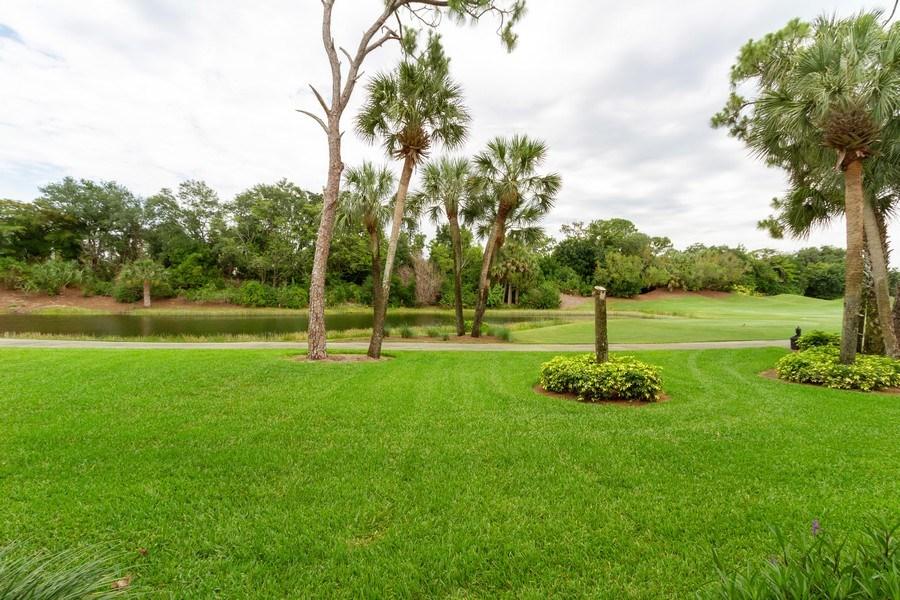 Real Estate Photography - 2130 Aberdeen Lane, #102, Naples, FL, 34109 - Lake