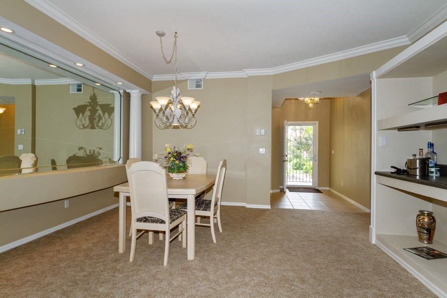 Real Estate Photography - 2130 Aberdeen Lane, #102, Naples, FL, 34109 - Dining Room