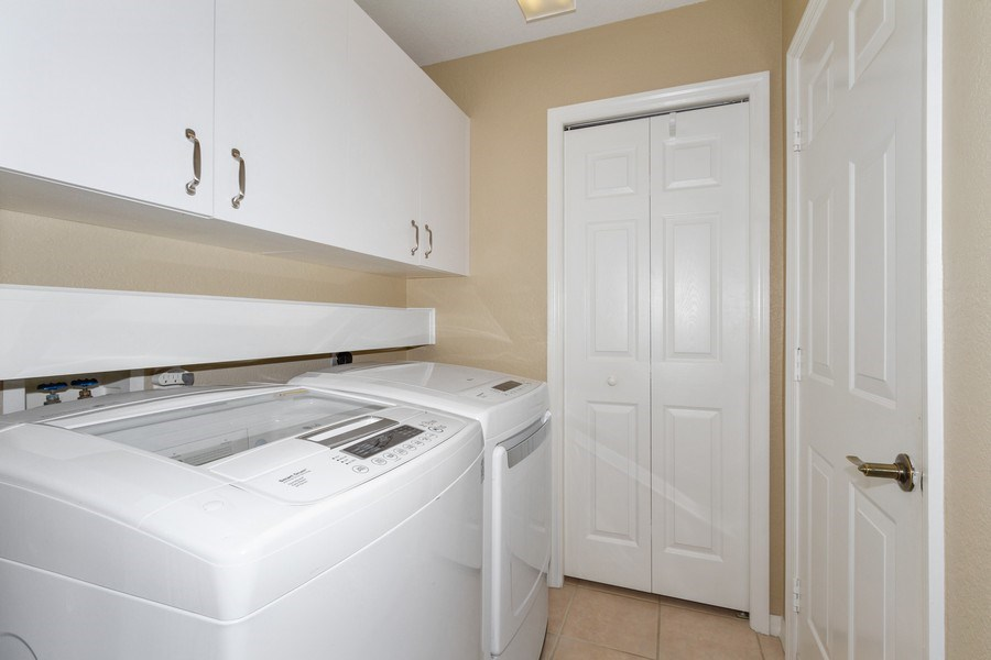 Real Estate Photography - 2130 Aberdeen Lane, #102, Naples, FL, 34109 - Laundry Room