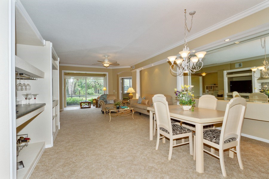 Real Estate Photography - 2130 Aberdeen Lane, #102, Naples, FL, 34109 - Living Room / Dining Room