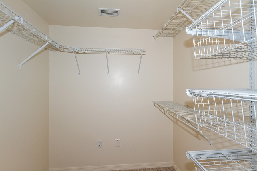 Real Estate Photography - 7416 Plumbago Bridge Rd, P-204, Naples, FL, 34109 - Master Bedroom Closet