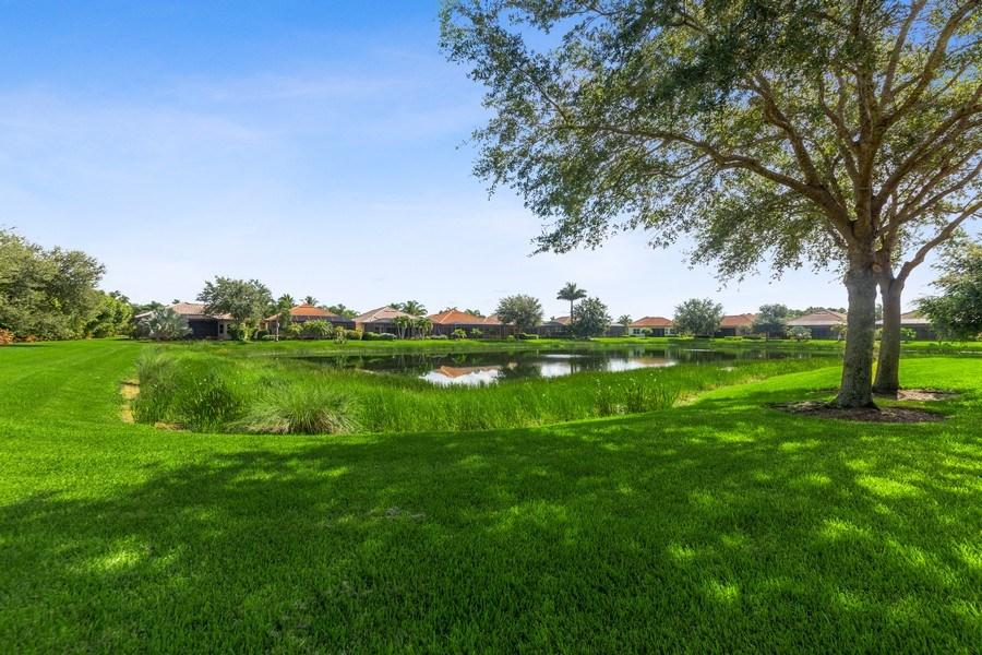 Real Estate Photography - 6061 Divot Ct, Naples, FL, 34113 - Lake