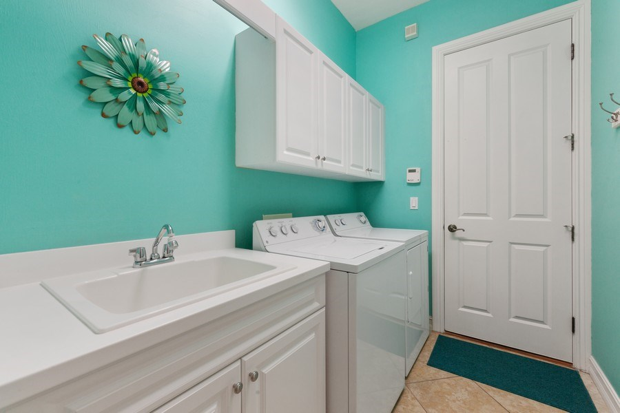 Real Estate Photography - 6061 Divot Ct, Naples, FL, 34113 - Laundry Room