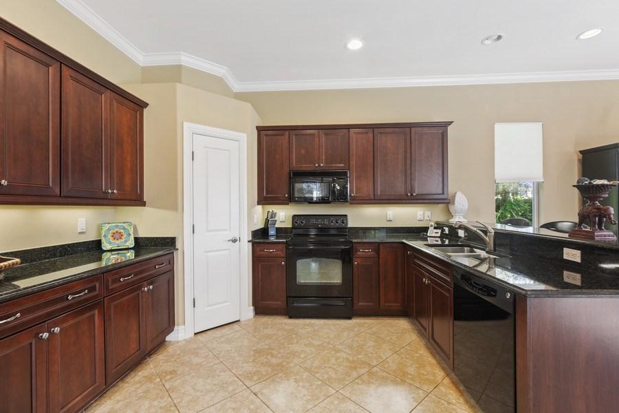 Real Estate Photography - 6061 Divot Ct, Naples, FL, 34113 - Kitchen