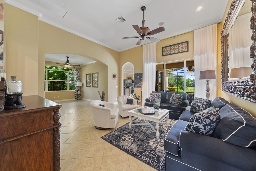 Real Estate Photography - 6061 Divot Ct, Naples, FL, 34113 - Living Room / Dining Room