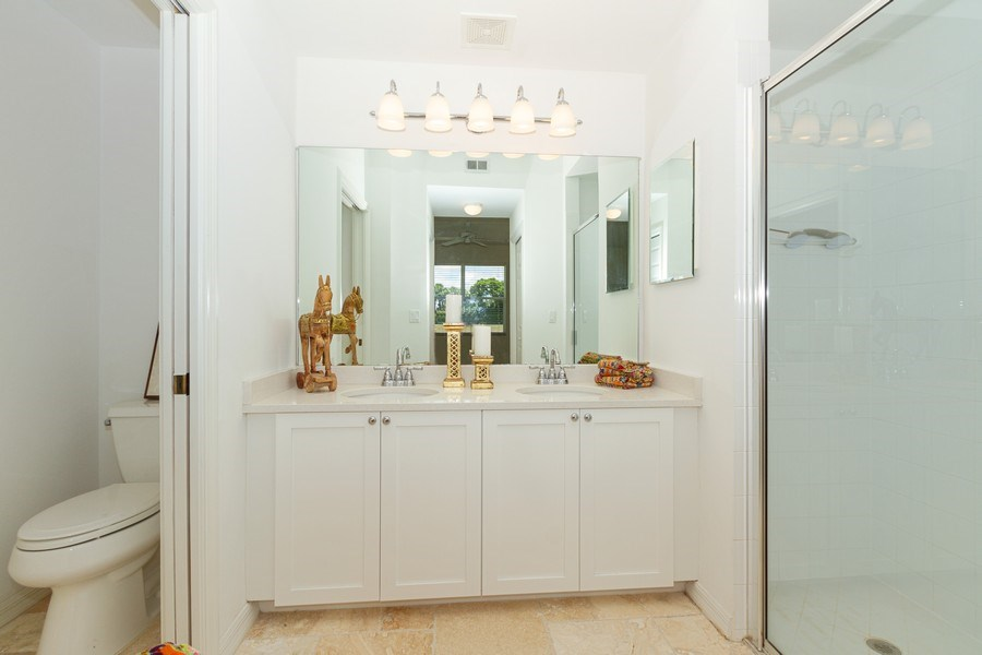 Real Estate Photography - 2310 Carrington Ct #101, Naples, FL, 34109 - Master Bathroom