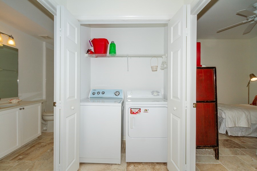 Real Estate Photography - 2310 Carrington Ct #101, Naples, FL, 34109 - Laundry Room