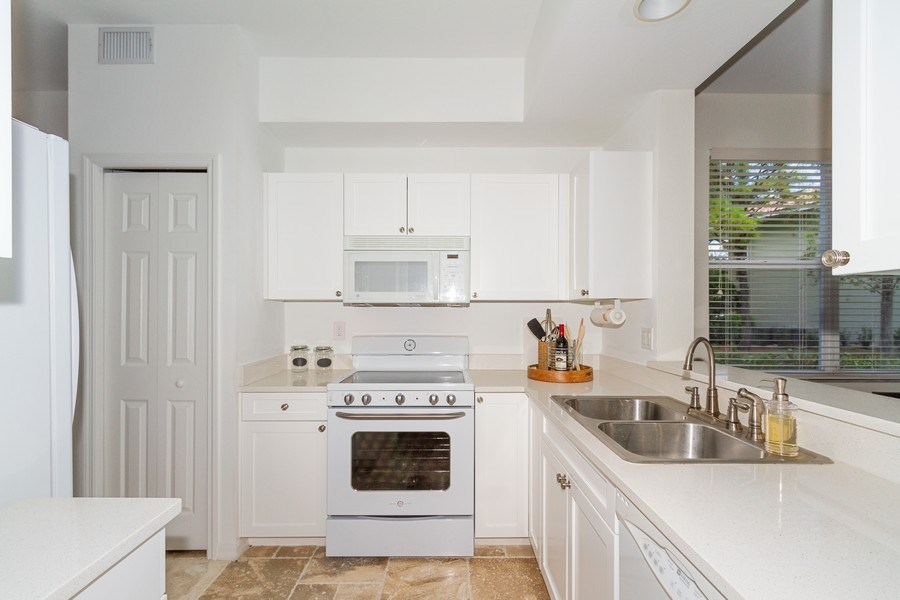 Real Estate Photography - 2310 Carrington Ct #101, Naples, FL, 34109 - Kitchen