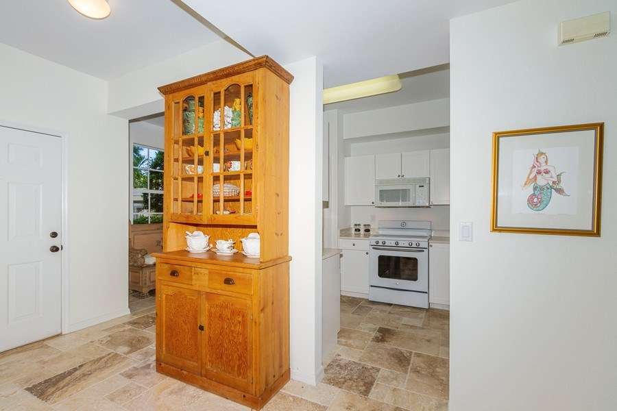 Real Estate Photography - 2310 Carrington Ct #101, Naples, FL, 34109 - Hallway