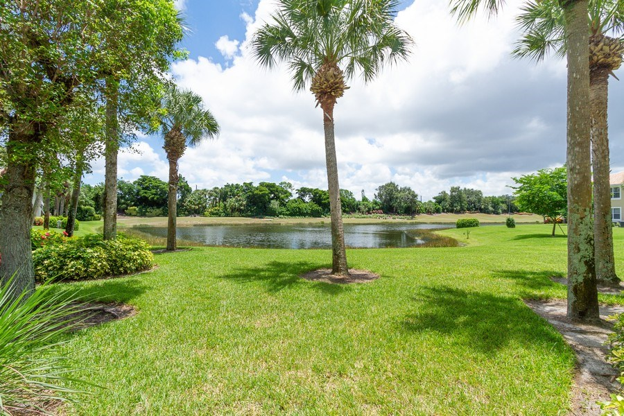 Real Estate Photography - 2310 Carrington Ct #101, Naples, FL, 34109 - Lake View