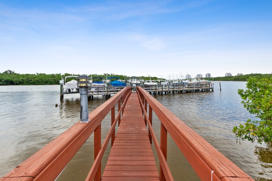 Real Estate Photography - 26171 Hickory Blvd, Unit 4A, Bonita Springs, FL, 34134 - Dock