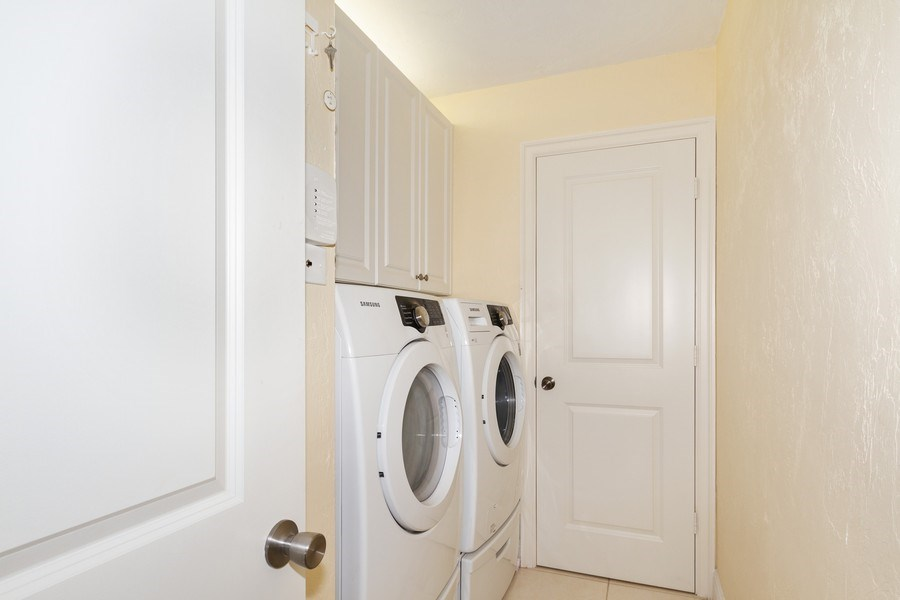 Real Estate Photography - 26171 Hickory Blvd, Unit 4A, Bonita Springs, FL, 34134 - Laundry Room