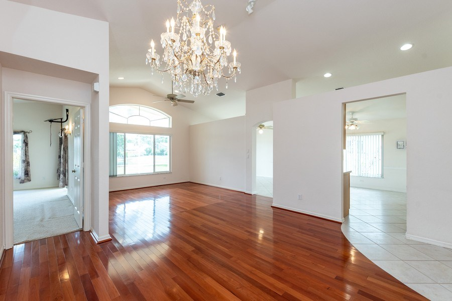 Real Estate Photography - 7529 Lourdes Ct, Naples, FL, 34104 - Family Room / Dining Room