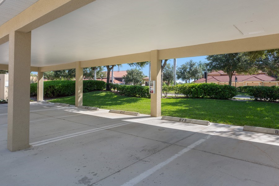 Real Estate Photography - 10285 Heritage Bay Blvd, Unit 825, Naples, FL, 34120 - Parking Area