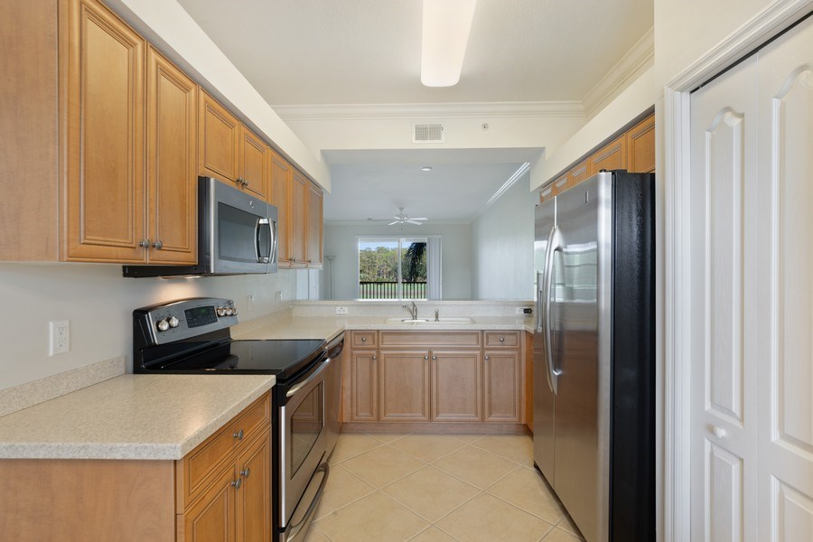 Real Estate Photography - 10285 Heritage Bay Blvd, Unit 825, Naples, FL, 34120 - Kitchen