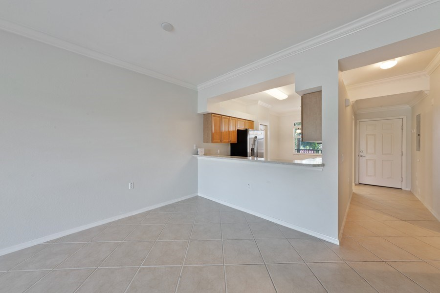 Real Estate Photography - 10285 Heritage Bay Blvd, Unit 825, Naples, FL, 34120 - Kitchen / Dining Room