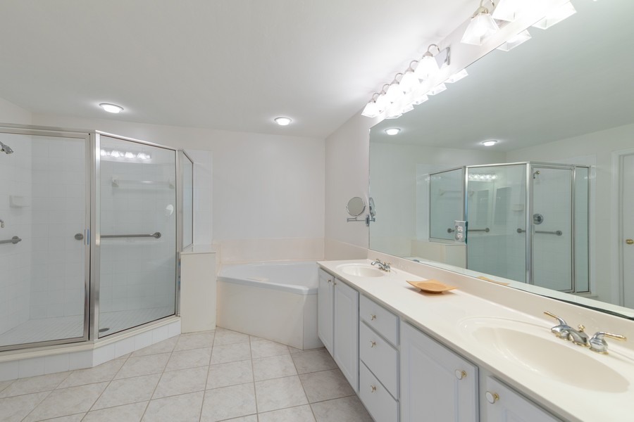 Real Estate Photography - 25090 Ballycastle Ct #103, Bonita Springs, FL, 34134 - Master Bathroom