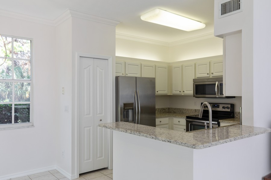 Real Estate Photography - 25090 Ballycastle Ct #103, Bonita Springs, FL, 34134 - Kitchen