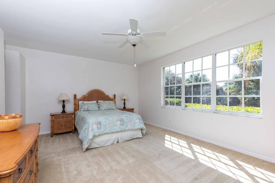 Real Estate Photography - 25090 Ballycastle Ct #103, Bonita Springs, FL, 34134 - Master Bedroom