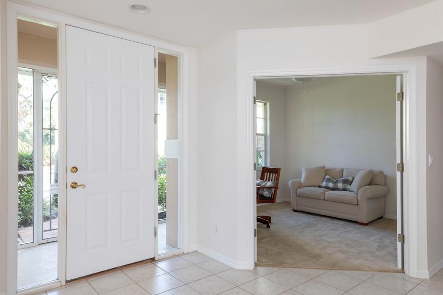 Real Estate Photography - 25090 Ballycastle Ct #103, Bonita Springs, FL, 34134 - Foyer