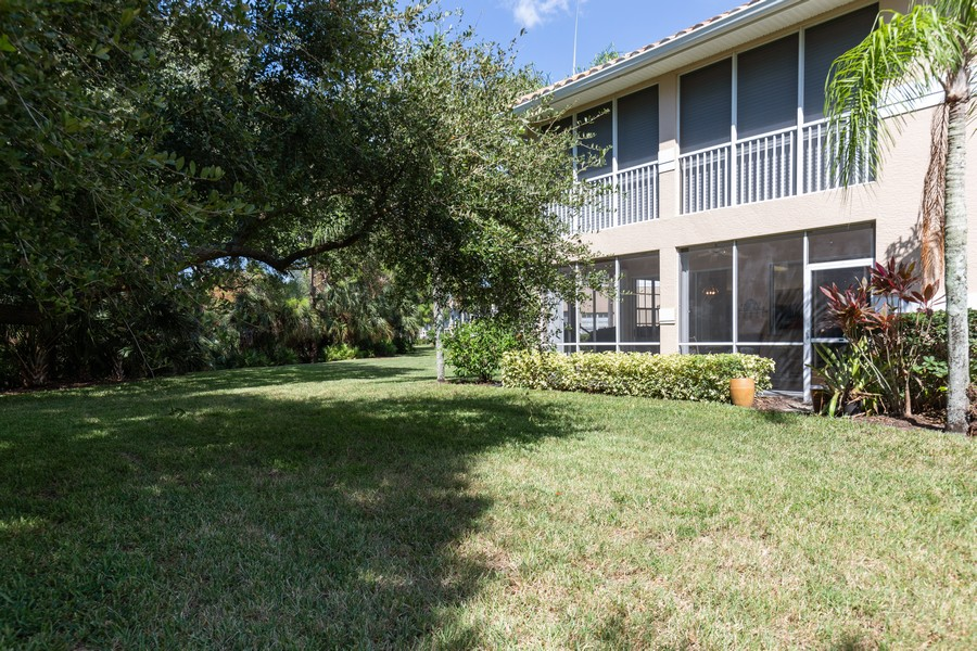 Real Estate Photography - 25090 Ballycastle Ct #103, Bonita Springs, FL, 34134 - Rear View