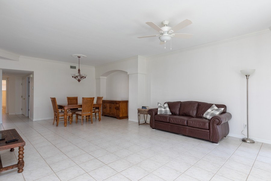 Real Estate Photography - 25090 Ballycastle Ct #103, Bonita Springs, FL, 34134 - Living Room/Dining Room