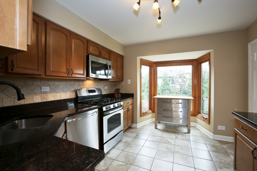 Real Estate Photography - 19W233 Old Tavern Road, 233, Oak Brook, IL, 60523 - Kitchen