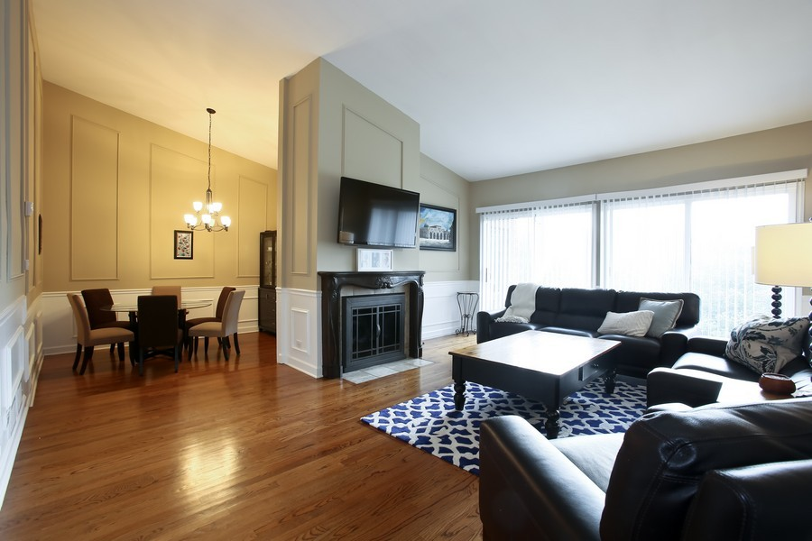 Real Estate Photography - 19W233 Old Tavern Road, 233, Oak Brook, IL, 60523 - Living Room / Dining Room