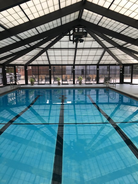 Real Estate Photography - 1555 N Astor, 48W, Chicago, IL, 60610 - Building Indoor Swimming Pool & Deck Beyond