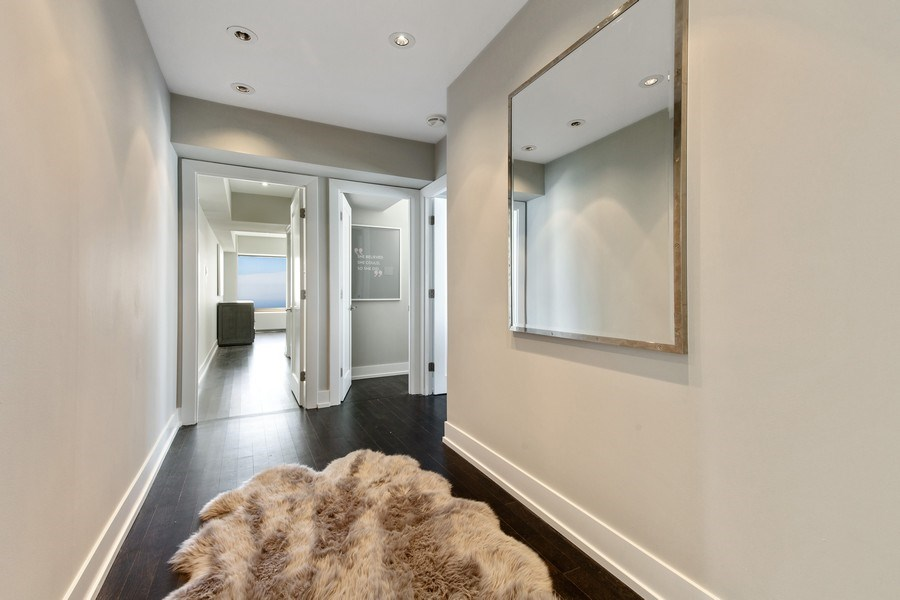 Real Estate Photography - 175 E Delaware, Unit 6402-03, Chicago, IL, 60611 - Hall to en-suite and BR3
