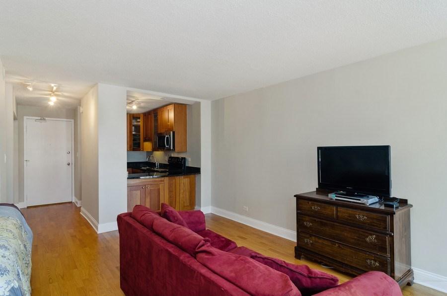 Real Estate Photography - 450 W Briar Pl, Unit 5E, Chicago, IL, 60657 - Kitchen / Living Room