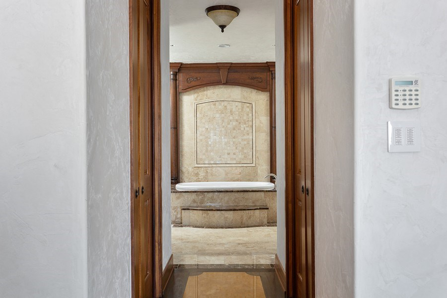 Real Estate Photography - 11001 Marquette Drive, New Buffalo, MI, 49117 - Master Bedroom to Walk In Closets & Bath