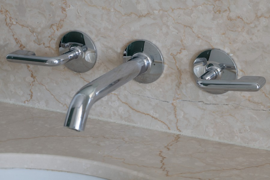 Real Estate Photography - 600 N. Fairbanks Ct., 2104, Chicago, IL, 60611 - Waterworks Bath Faucets