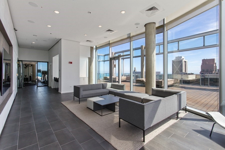 Real Estate Photography - 600 N. Fairbanks Ct., 2104, Chicago, IL, 60611 - 41st Floor Lounge & Kitchen