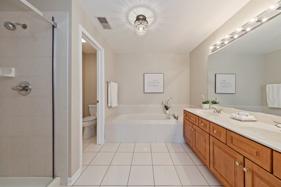 Real Estate Photography - 6211 Edgebrook Lane West, Indian Head Park, IL, 60525 - Master Bath with His & Hers Sinks & Closets