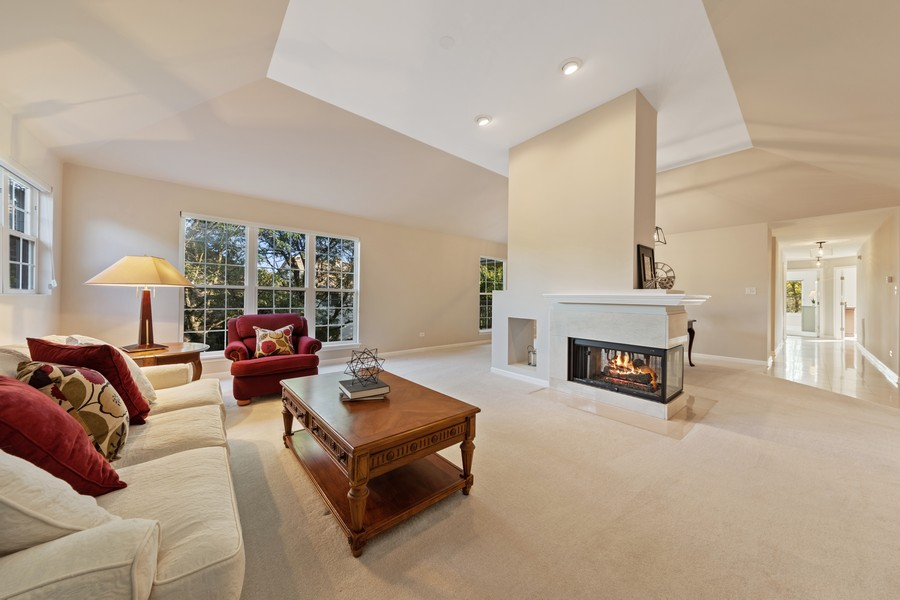 Real Estate Photography - 6211 Edgebrook Lane West, Indian Head Park, IL, 60525 - Sunlit Living Room with Double Sided Fireplace