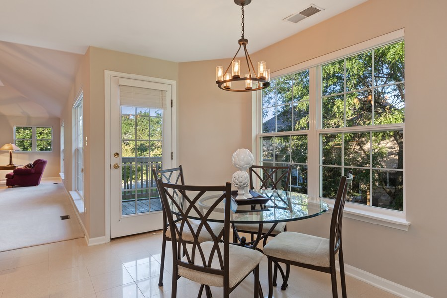 Real Estate Photography - 6211 Edgebrook Lane West, Indian Head Park, IL, 60525 - Great Breakfast Area Leads to Deck