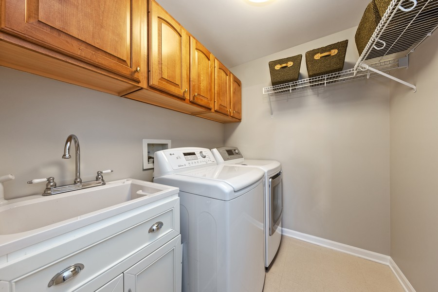 Real Estate Photography - 6211 Edgebrook Lane West, Indian Head Park, IL, 60525 - Laundry Room with Utility Sink & Storage