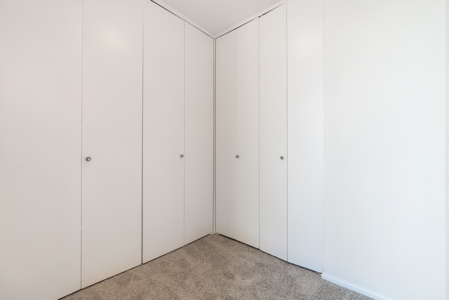 Real Estate Photography - 5201 S Cornell 19A, Chicago, IL, 60615 - Master Bedroom Closet