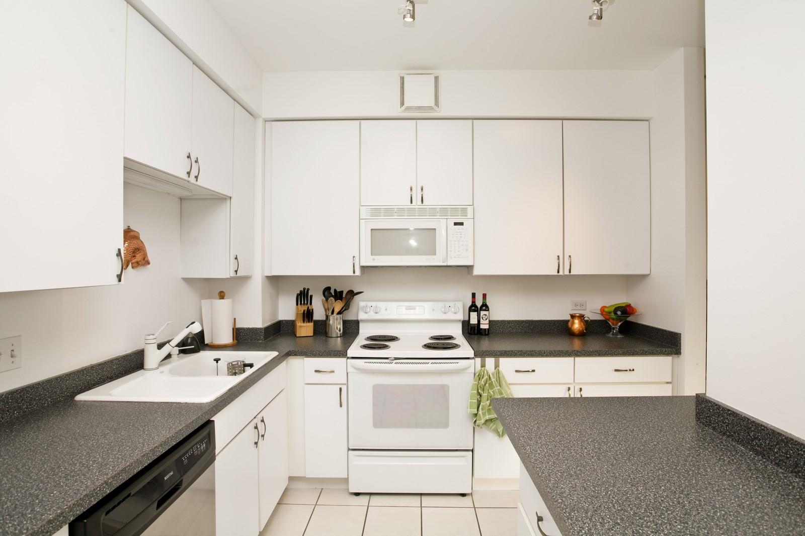 Real Estate Photography - 435 W Erie, Unit 807, Chicago, IL, 60654 - Kitchen