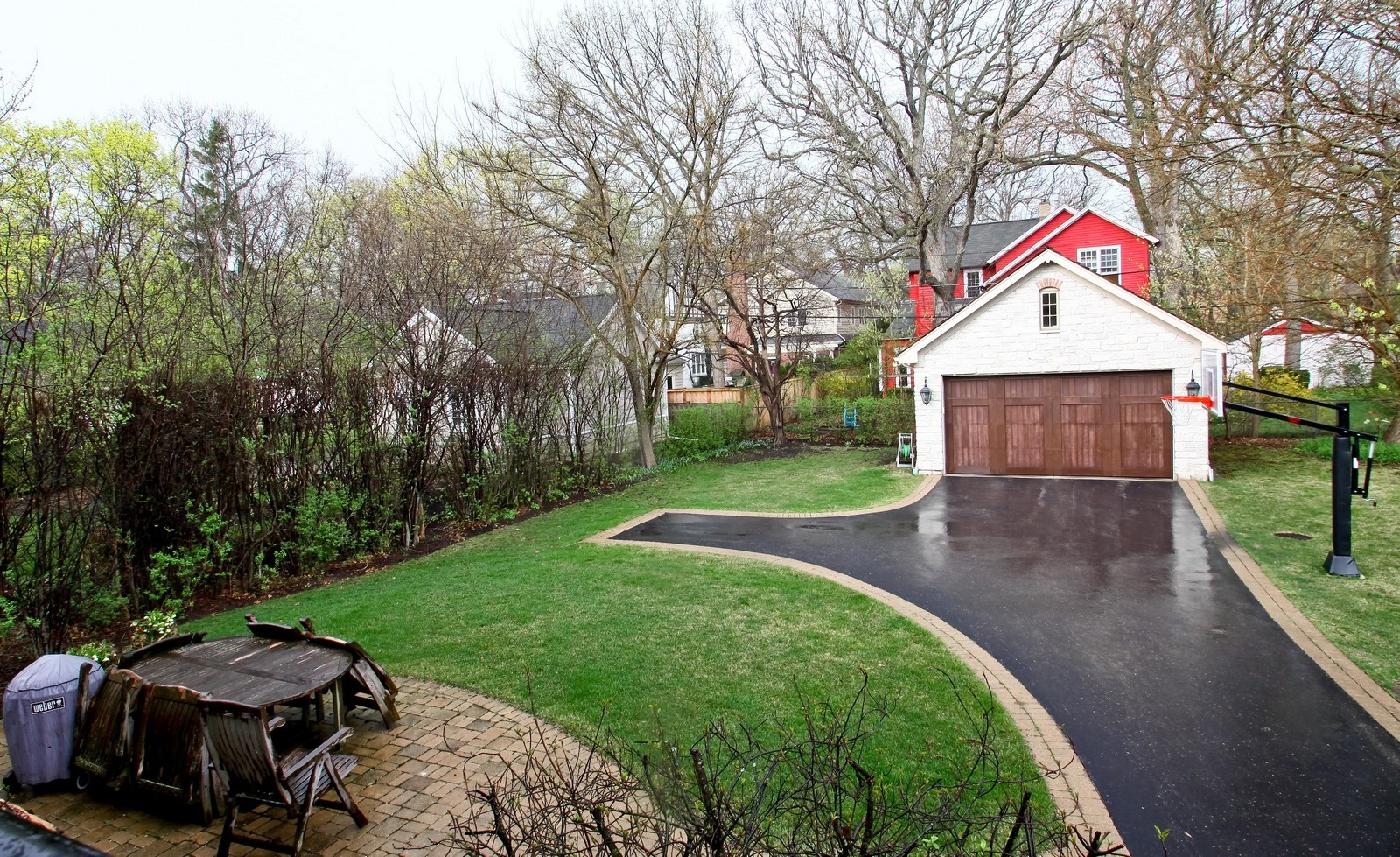 Real Estate Photography - 431 Adams Ave, Glencoe, IL, 60022 - Lush yard, brick patio and heated garage.