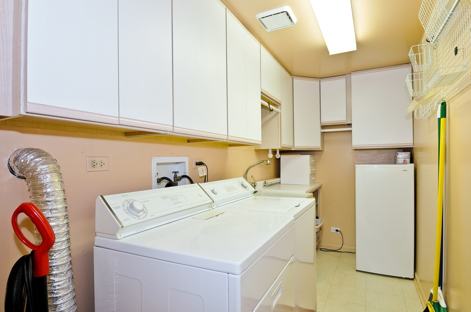 Real Estate Photography - 4545 Touhy, Unit 516, Lincolnwood, IL, 60712 - Laundry Room