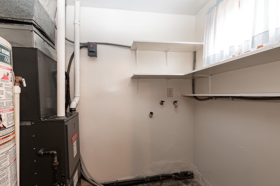 Real Estate Photography - 3714 Shawnee Dr, Kansas City, KS, 66106 - Laundry Room