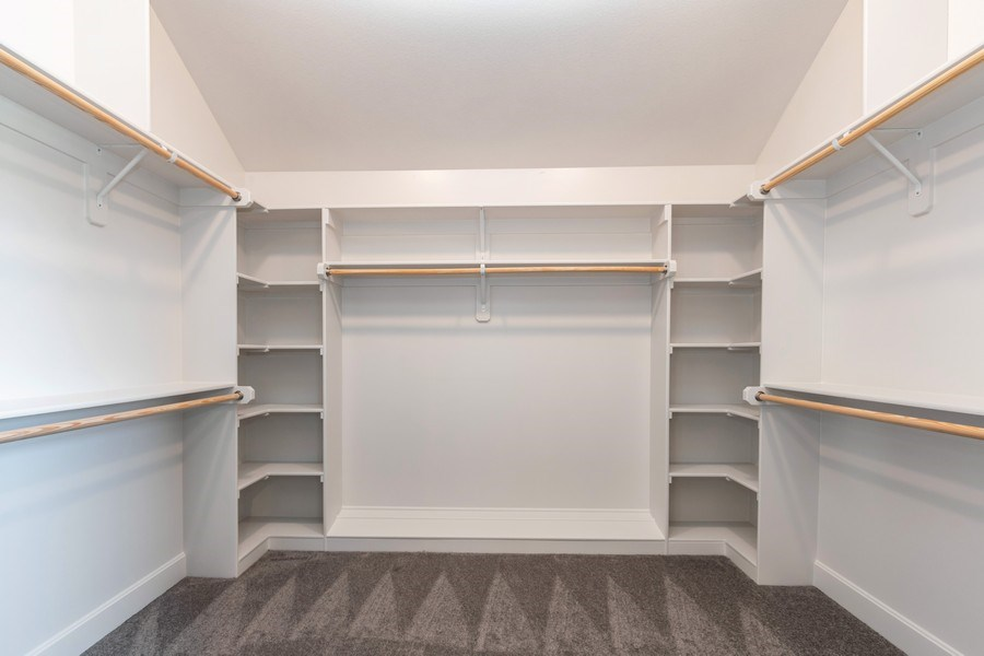Real Estate Photography - 16200 Stearns St., Overland Park, KS, 66221 - Master Bedroom Closet