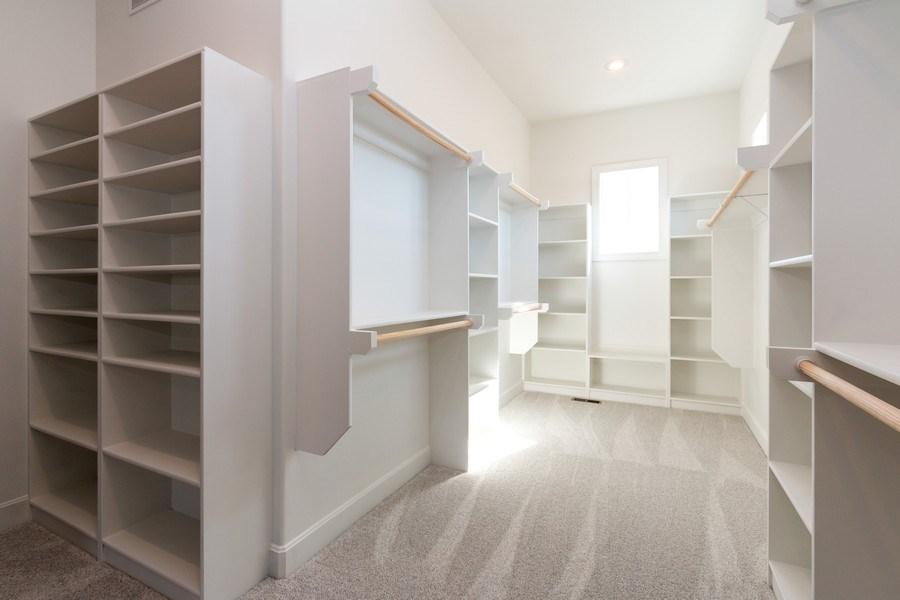 Real Estate Photography - 16204 Stearns St., Overland Park, KS, 66221 - Master Bedroom Closet