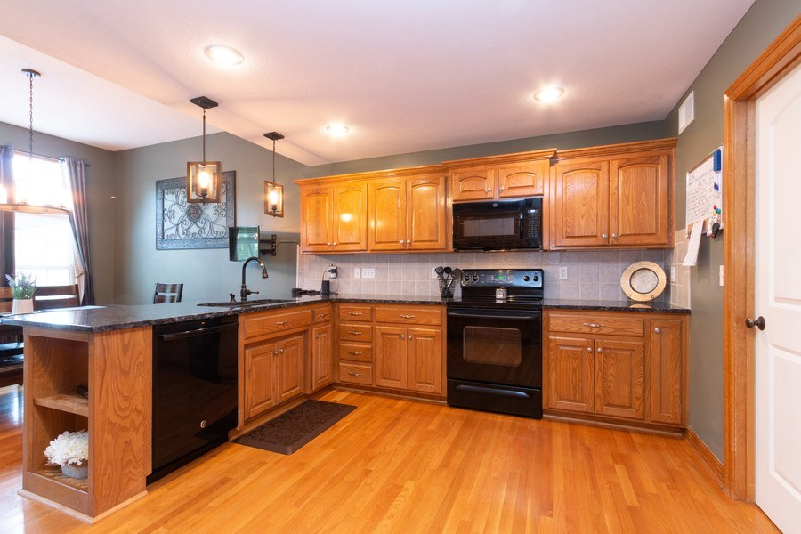 Real Estate Photography - 1013 SW Whistle Drive, Lee's Summit, MO, 64082 - Updated Kitchen
