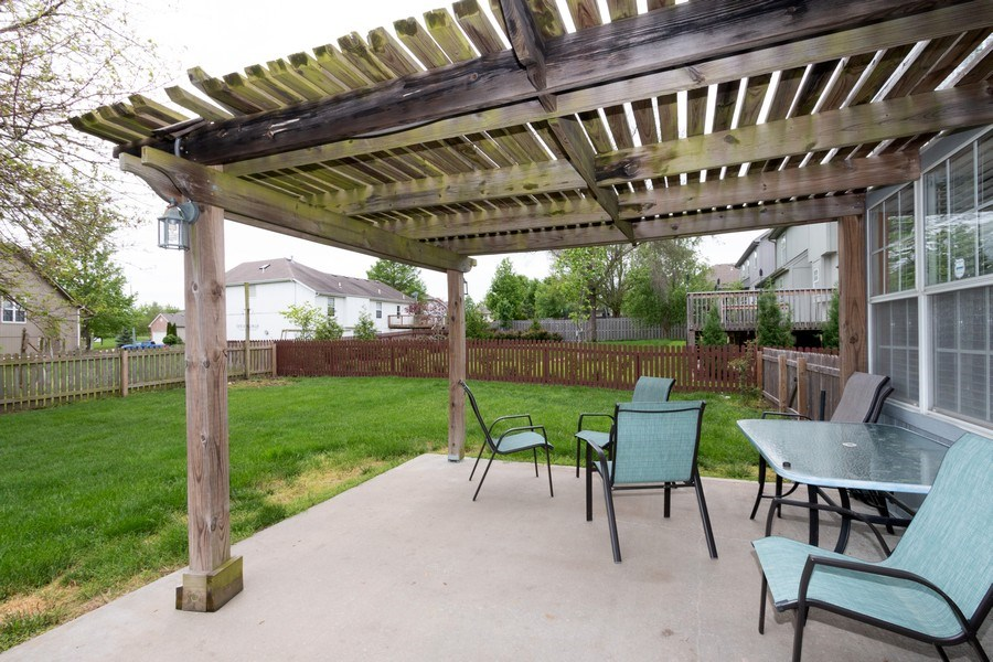 Real Estate Photography - 1013 SW Whistle Drive, Lee's Summit, MO, 64082 - Perfect Pergola & Patio for Parties