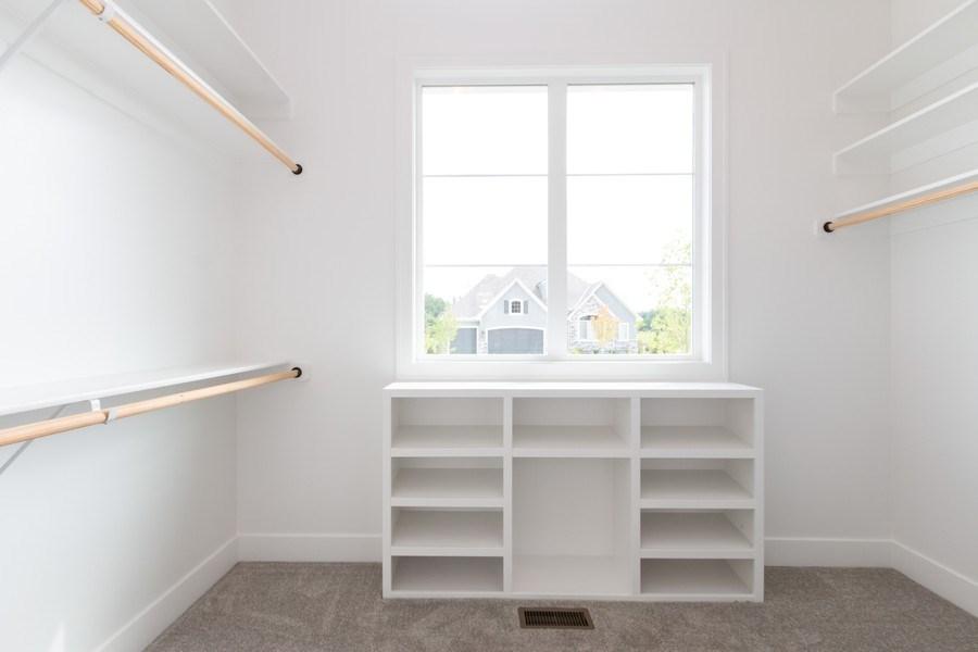 Real Estate Photography - 16104 Melrose St., Overland Park, KS, 66221 - Master Bedroom Closet