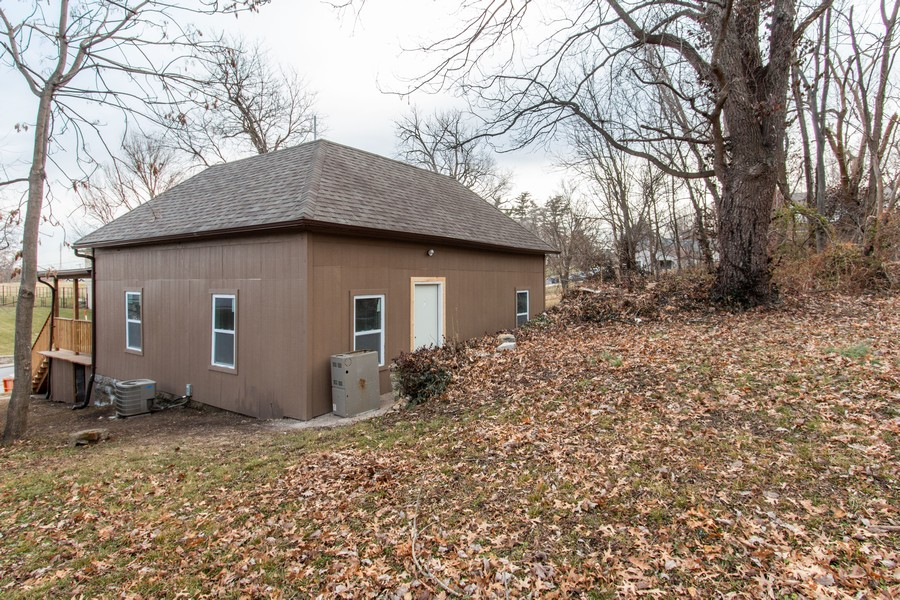 Real Estate Photography - 610 St Louis Ave, Excelsior Springs, MO, 64024 - Rear View