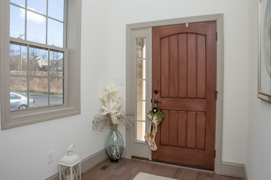 Real Estate Photography - 74 Centerville Rd, Wilmington, DE, 19808 - Open front entry with hardwood flooring